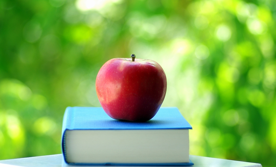 bigstock-Red-Apple-On-A-Book-1716335